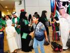 Saudi passengers being welcomed at Dubai airport yesterday. A special entry stamp was issued to mark Saudi National Day.