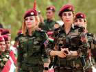 Iraqi Kurdish peshmergas take part in a gathering to urge people to vote in the in Arbil, the capital of the autonomous Kurdish region of northern Iraq, on Wednesday.