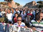 People take to the streets in support of refugees during a rally staged by the 'Movements for Home' in Rome.
