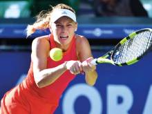 Wozniacki storms past world No. 1 Muguruza