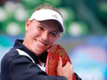 Wozniacki romps to Tokyo crown in no time