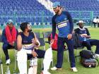 Sri Lankan captain Dinesh Chandimal (second right) and Vice Captain, Lahiru Thirimanne (2nd right) discuss during the team's training session at Shaikh Zayed Cricket Stadium in Abu Dhabi.