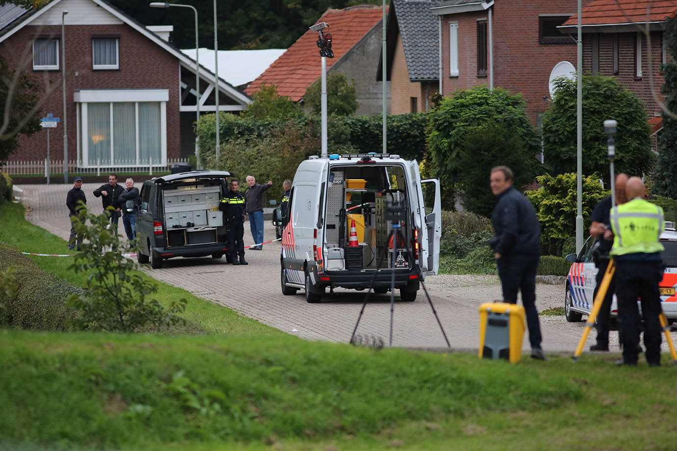 Policemen investigate on October 11, 2017, in Roosteren, near the site where a man was shot dead by