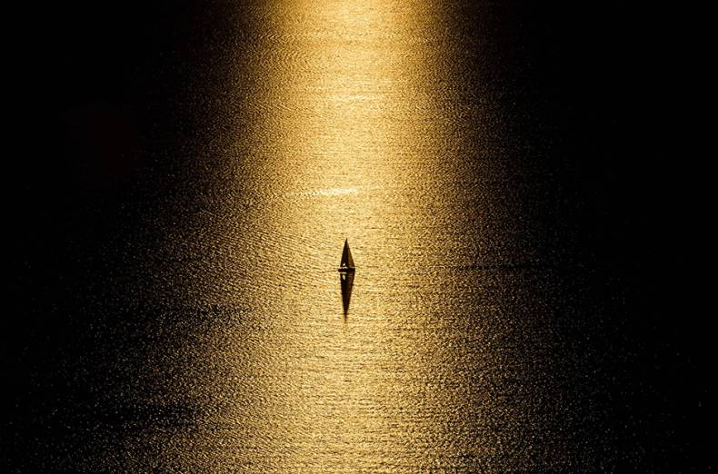 a-boat-is-seen-at-sunset-on-lake-geneva-from-chexbres-western-switzerland