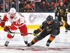 Dylan Larkin (left) of the Detroit Red Wings skates with the puck as William Karlsson of the Vegas Golden Knights attempts to block in the third period of their game.