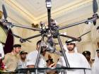 Shaikh Mansour Bin Mohammad Bin Rashid Al Maktoum looking at Dubai police surveillance drone at the Unmanned Aerial System Forum in Dubai.