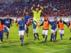 Italian players celebrate after winning a qualification match against Albania on October 9. The Italians were condemned to the play-offs after finishing runners-up to Spain in their qualifying group.