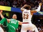 Boston Celtics' Gordon Hayward (20) lands heavily in the leadup to his injury after leaping for a pass from Kyrie Irving while Cleveland Cavaliers' LeBron James reaches for the loose ball.