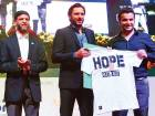 From Left: Dr Faisal Ikram, President of PAD, Shahid Afridi, and a member of the audience auctioning a T-shirt.