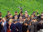 Houston Astros celebrate with the trophy after Game Seven of the 2017 ALCS play-off series against New York Yankees.