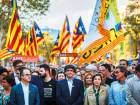 Carles Puigdemont, Catalonia's president, center, participates in a demonstration against the Spanish government and the imprisonment of separatist leaders Jordi Sanchez, head of the Catalan National Assembly, and Jordi Cuixart, head of Omnium Cultural, on the Gran Via Avenue in Barcelona, Spain.