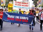 Refugee advocates hold placards as they participate in a protest in central Sydney, against the treatment of asylum-seekers in detention centres located in Nauru and on Manus Island, Australia.