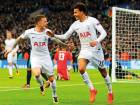 Tottenham's Dele Alli is congratulated by teammate Kieran Trippier (left) after scoring the opening goal during the Champions League Group H match in London on Wednesday. Alli's double was the highlight of Tottenham's famous win at the Wembley.