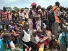 Men, women and children line up to be registered with the World Food Programme (WFP) for food distribution in Old Fangak, in Jonglei state, South Sudan.