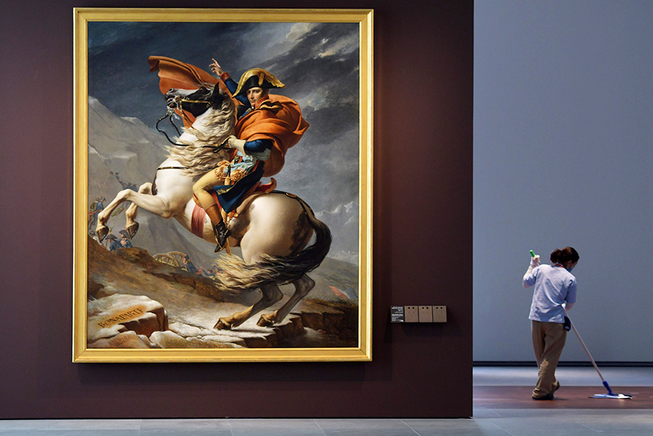 A painting titled 'Napoleon Bonaparte, First Consul, Crossing the Alps' displayed at the Louvre Abu