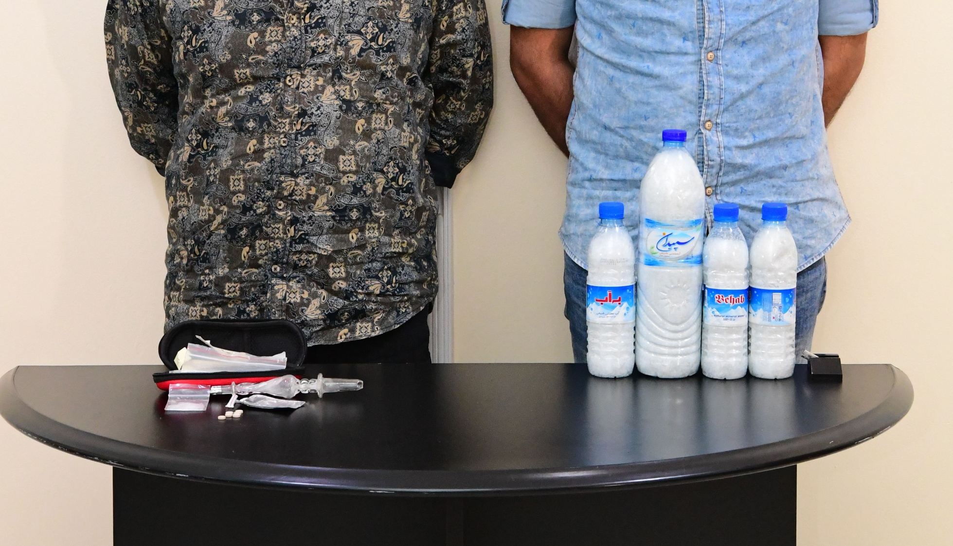 The 2 suspected drug dealers with some of the banned narcotics found in their possession