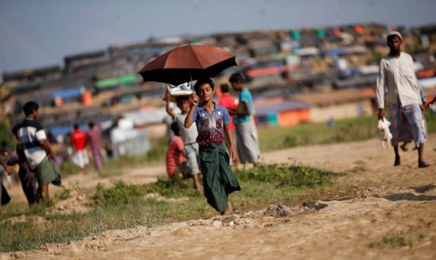 Rohingya refugee boy works to support family