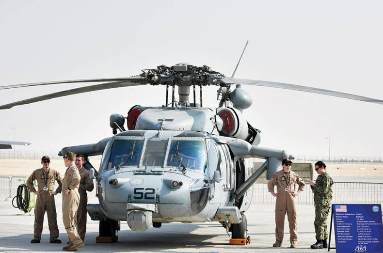 exhibitors-stand-next-to-mh60r-at-us-display-stand-at-dubai-world-central