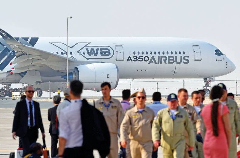 an-airbus-a350-waiting-for-flying-display-on-the-opening-day-as-flying-enthusiasts-mill-around