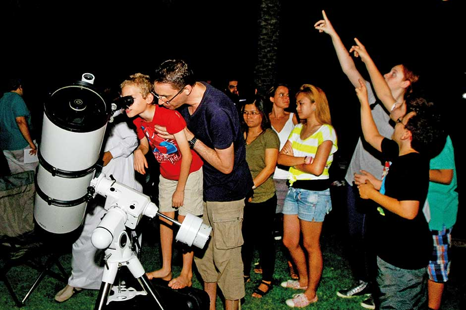 People watch a meteor shower in Dubai in May 2014.