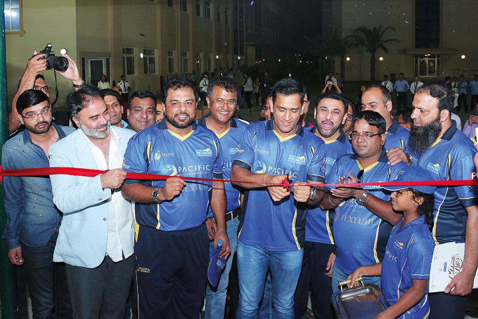 Dhoni cuts the tape to officially inaugurate his academy