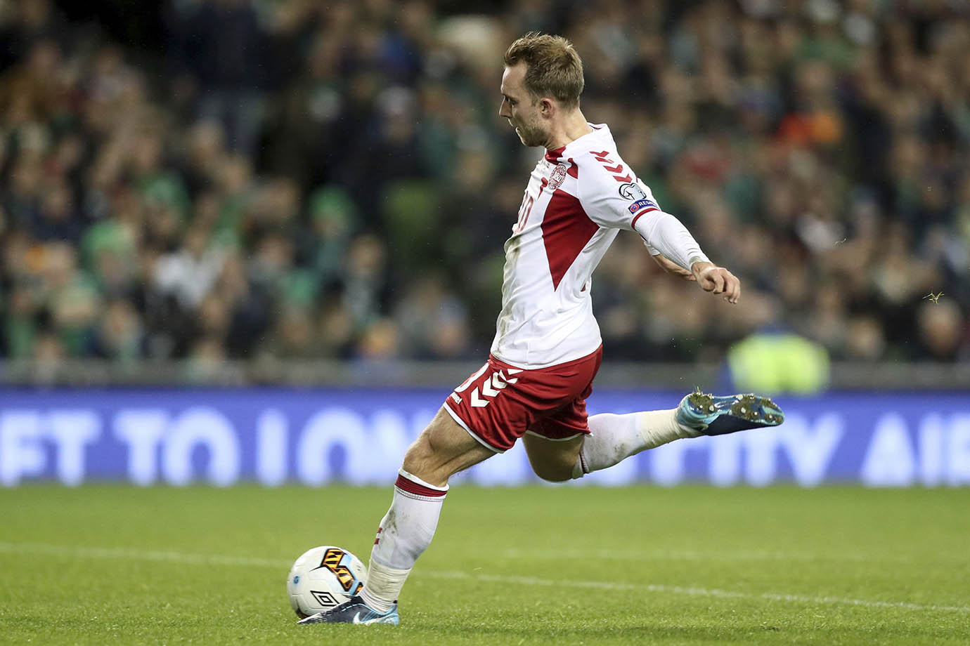 Denmark's Christian Eriksen scores his side's fourth goal.