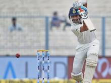 Pujara holds out as India struggle