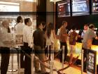 People queue to buy tickets at Reel Cinemas, The Dubai Mall