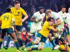 England's Joe Lunchbury  (second right) is tackled by Australia's Ben McCalman during their rugby union international match between England and Australia at Twickenham stadium in London.
