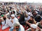 Supporters of a Pakistani radical religious party shout slogans during a sit-in protest at an intersection of Islamabad, Pakistan.