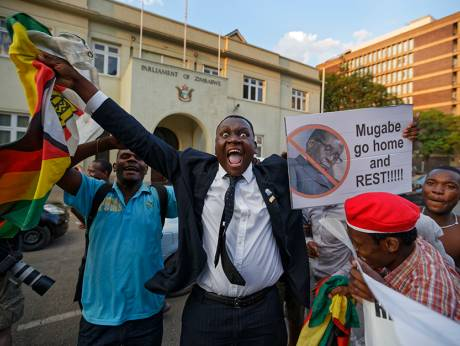 Zimbabweans celebrate outside the parliament building