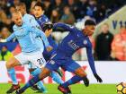 Manchester City's David Silva (left) vies with Leicester City's Demarai Gray during the Premier League matc.