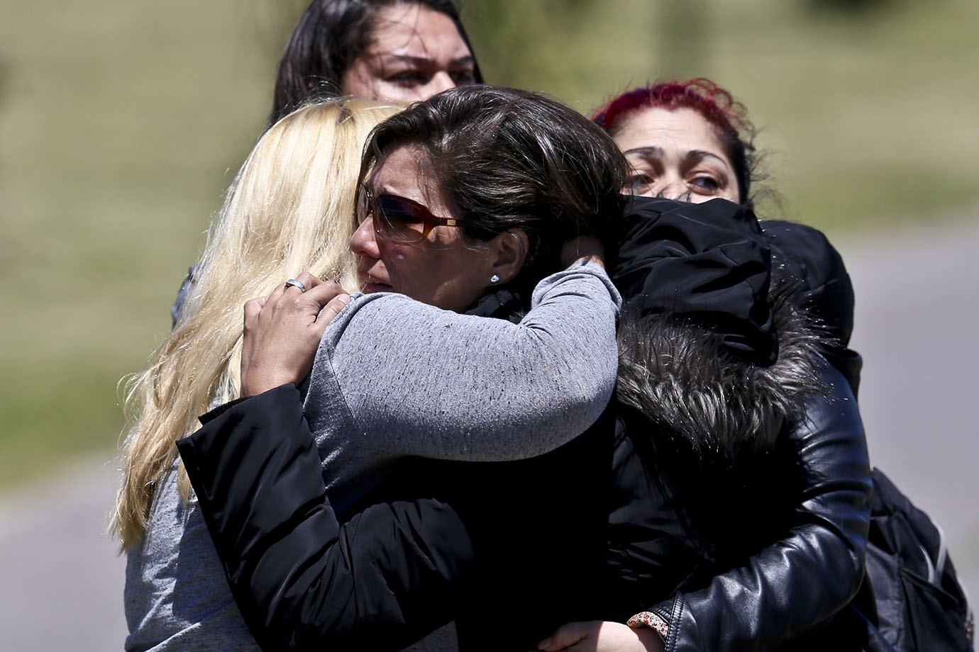 Relatives of missing submarine crew member Celso Oscar Vallejo, react to the news that a sound detec