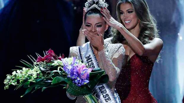 Former Miss Universe Iris Mittenaere (right) crowns new Miss Universe Demi-Leigh Nel-Peters