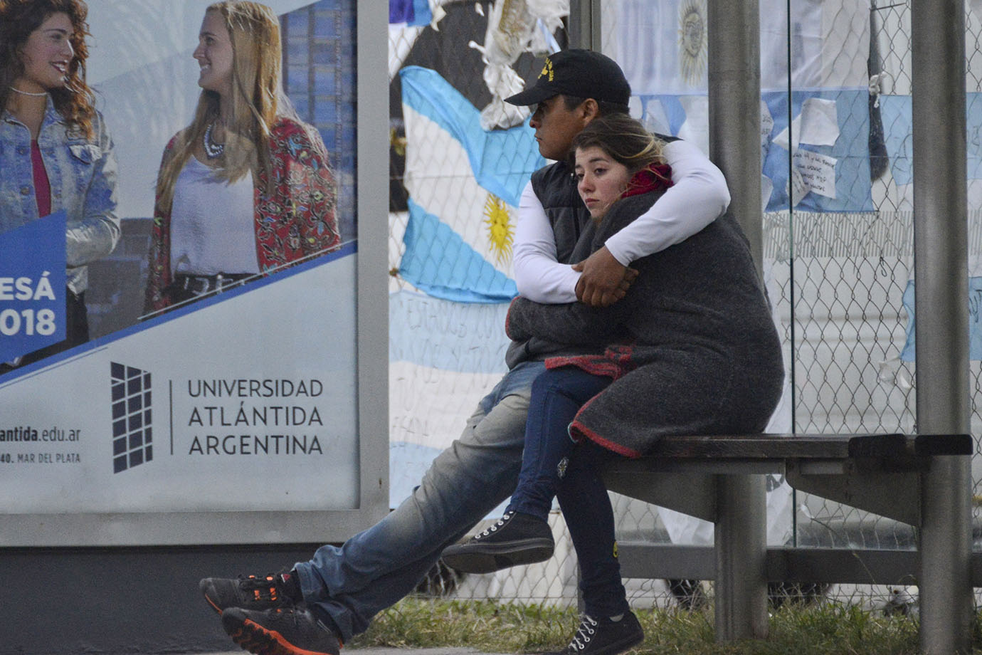 Relatives of crew members from the missing ARA San Juan submarine hug outside the navy base in Mar d