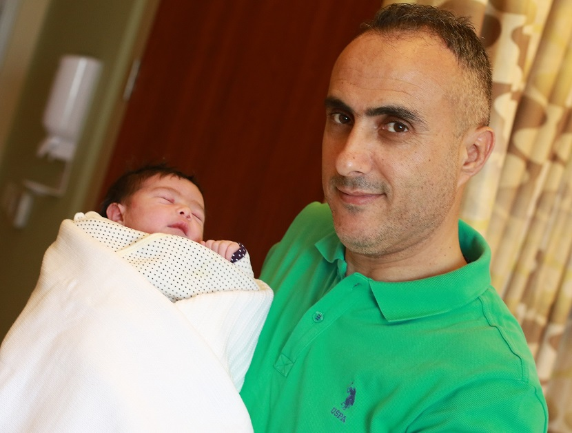 Baby Sama with her Father – Mohammed Alsantarisi – baby born at 12:05 after midnight on UAE National