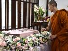 A Buddhist monk blessing the body of Dollar, a six-year-old Shih Tzu dog, during the pet's funeral at Wat Krathum Suea Pla Buddhist temple in Bangkok.