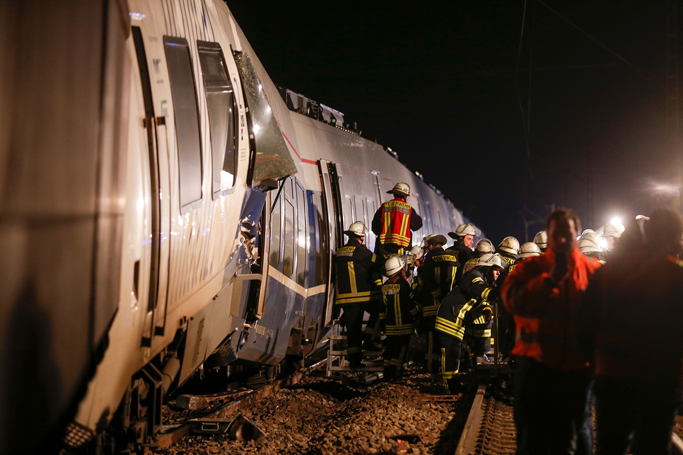 Firefighters work on the site of a train accident on December 5, 2017 in Meerbusch-Osterath, western