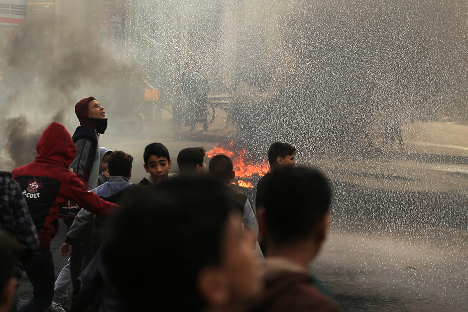 Palestinian youths take part in a protest