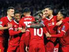 Philippe Coutinho in the No 10 shirt gets his Liverpool teammates in a celebratory mood after scoring his side's fifth goal during the Champions League Group E match against Spartak Moscow.