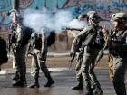 Israeli forces clash with Palestinian protestors near an Israeli checkpoint in the West Bank city of Bethlehem.