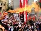 Protesters set a U.S flag on fire near the U.S. embassy in Awkar north of Beirut, Lebanon.