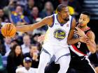 Golden State Warriors' Kevin Durant (35) stepped up with 28 points in the absence of Stephen Curry and Draymond Green to help beat the Blazers 111-104, in Oakland, California.