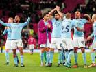 Manchester City's Raheem Sterling and team mates celebrate after victory over Manchester United on Sunday - their 14th straight win in the Premier League — a single season record that also equalled the best-ever run Arsenal in 2002.