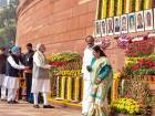 Prime Minister Narendra Modi, former prime minister Manmohan Singh and other dignitaries while paying tribute to the martyrs of 2001 Parliament attack on its 16th anniversary, at Parliament House in New Delhi on Wednesday.