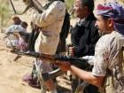 Yemeni tribesmen from the Popular Resistance Committees, supporting forces loyal to Yemen's Saudi-backed President, hold a position during clashes with Al Houthi rebels and their allies in Bayhan, in the Shabwa province, on Friday.