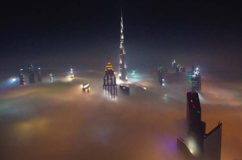 an-ethereal-bird-s-eye-view-of-dubai-s-skyscrapers-during-fog
