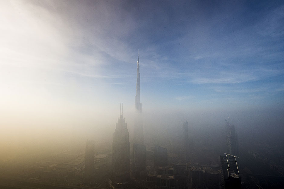 Fog swamps Burj Khalifa along with its surrounding towers in Dubai
