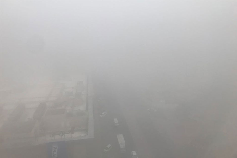 Fog covered Buhaira Corniche area in Sharjah