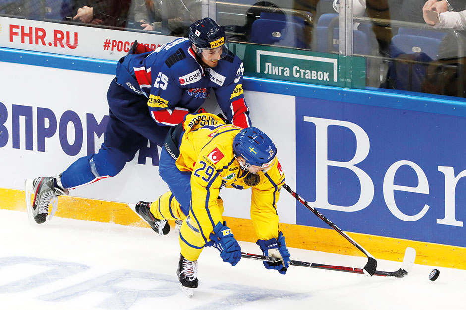 South Korea's Brock Radunske in action against Sweden's Erik Gustafsson during the Channel One Cup